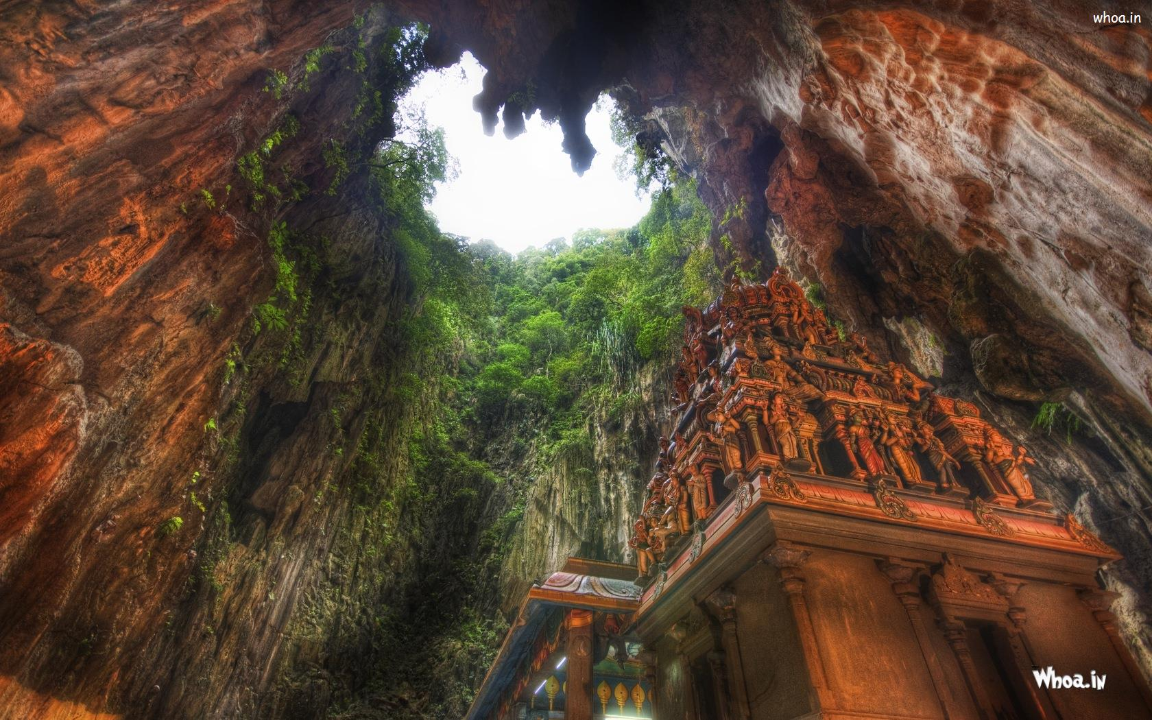 A Shrine For The Hindu God Murugan In The Middle Of A Large Cavern