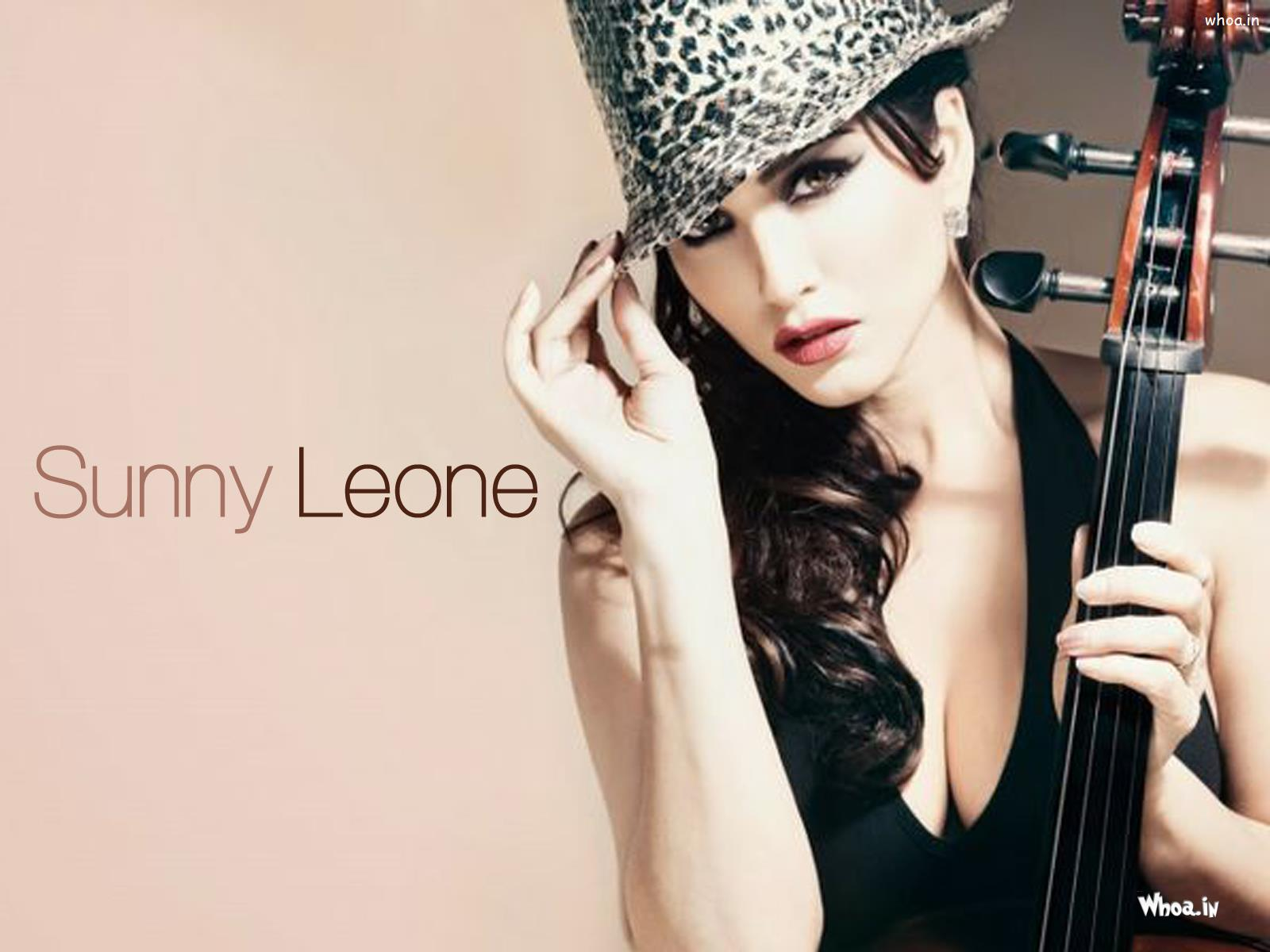 Close Up Sunny Leone With Guitar Hd Wallpaper