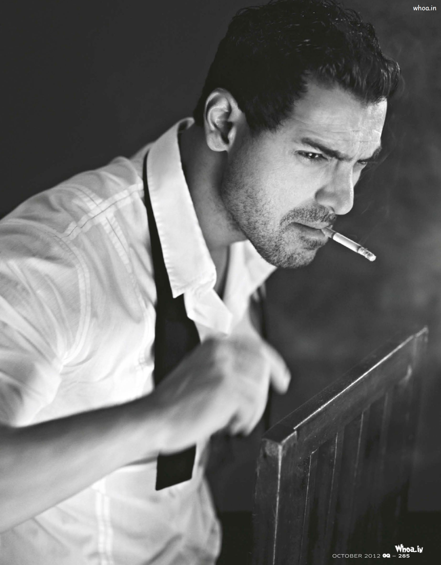 John abraham smoking with black and white image