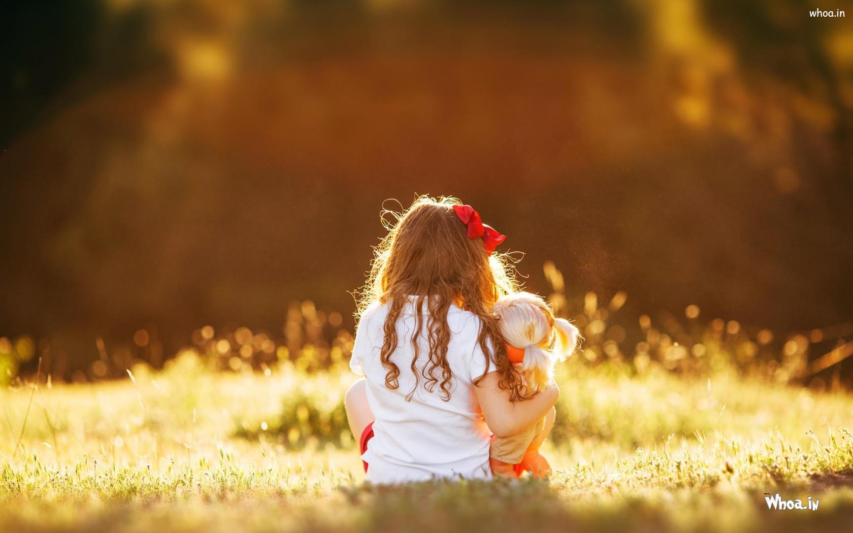 little child girl with baby doll hd cute baby wallpaper