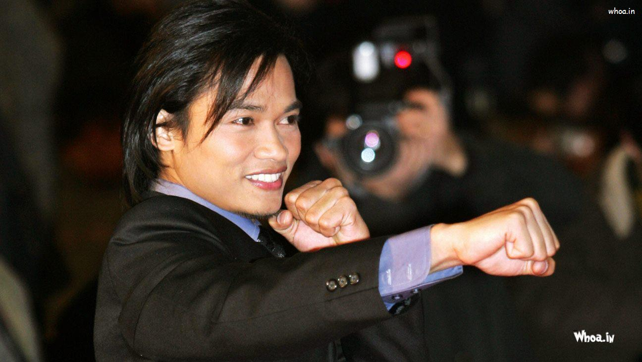 Jaa Minimalist tony jaa black suit and stylish hair style wallpaper
